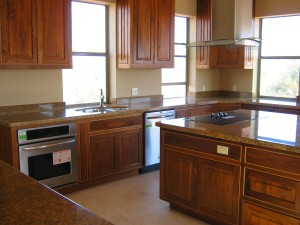 Amazing gourmet kitchen with custom walnut cabinets